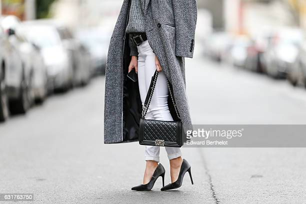 May Berthelot Head of Legal at Videdressingcom and influencer MayMaryB is wearing a Marks and Spencer oversized gray coat Topshop white denim jeans a...
