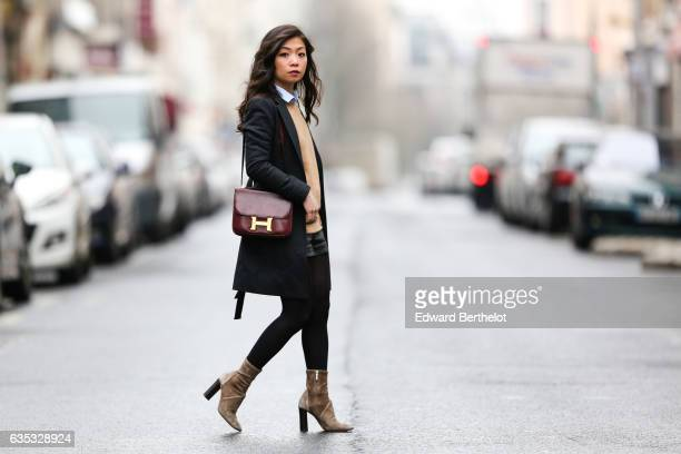 May Berthelot Head of Legal at Videdressioncom and fashion blogger wears Zara camel suede boots a The Kooples black leather short a Topshop shirt a...
