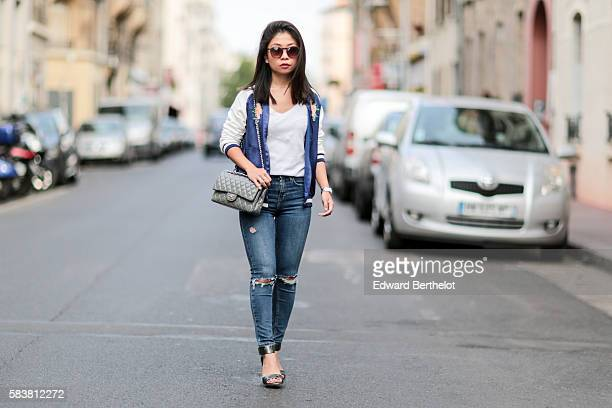 May Berthelot is wearing a Zara blue bombers jacket featuring a flower and a bird Topshop blue jeans HM sandals a Cartier Pasha watch Sarah Lavoine...