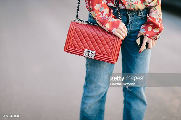 May Berthelot is wearing a Zara red body with floral print a Zara black lace tank top Maje blue denim boyfriend jeans Louboutin Pigalle Plato shoes a...