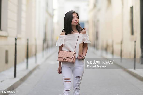 May Berthelot is wearing Chanel black espadrilles shoes Zara white ripped jeans a Topshop nude Bardot top a Darris pink clutch and a Chanel Timeless...