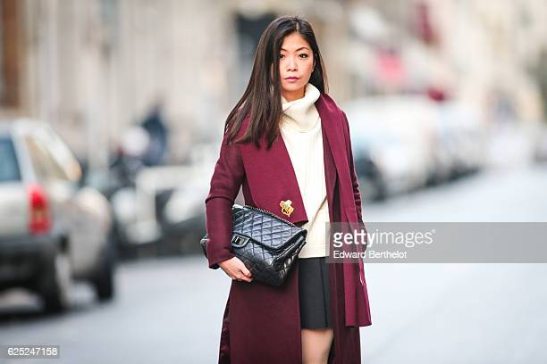May Berthelot is wearing New Look babies shoes a Topshop skirt New Look purple burgundy coat a Chanel 255 black bag Chanel bicolor tights with CC...