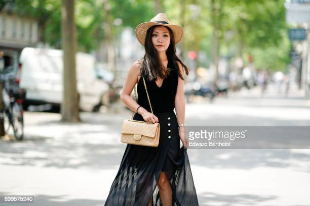 May Berthelot wears a Luie black velvet body top a The Kooples ruffled lace skirt New Look sandals a straw camel hat and a Chanel Timeless bag...