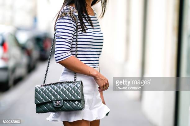 May Berthelot wears a Sandro striped top Zara white shorts Zara sandals and a Chanel Timeless bag during Paris Fashion Week Menswear Spring/Summer...