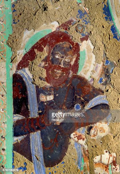 May Cave n°14 Kyzyl Xinjiang China The face of this meditating ascetic appears at the top of the cave's left wall on the left of the Buddha's throne...