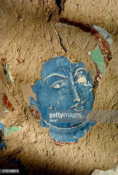 May Cave n°224 Kyzyl Xinjiang China A blue face appears on the wall as if it was floating On top of deteriorations caused by time there are the ones...