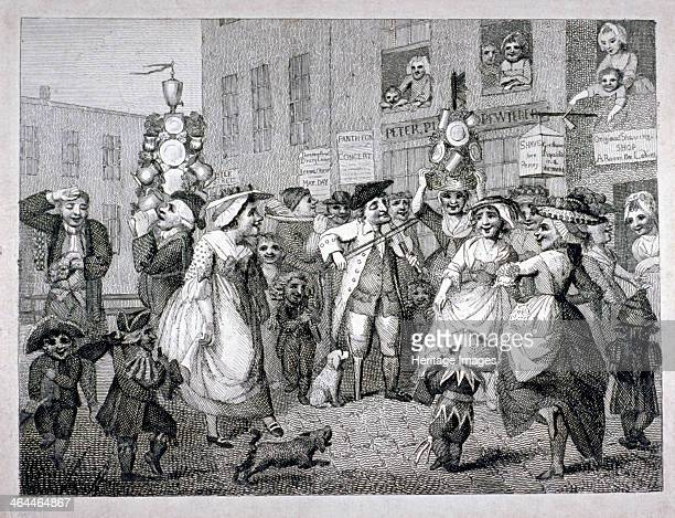 'May Day ' 1784 Milkmaids with garlands and chimney sweep boys dancing outside a pewterer's and a barber's premises in Milk Street One garland of...