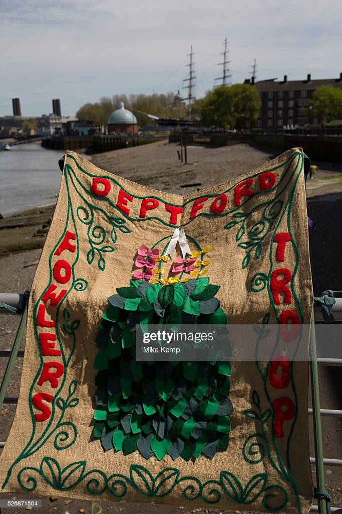 May Day custom of Deptford Jack in the Green, a man encased in a framework entirely covered with greenery, is one of the lesser-known modern revivals (by the Blackheath Morris Men) of English traditional customs on May 1st 2016 in London, United Kingdom. Working it's route along the river, the Jack reaches Greenwich. Fowlers Troop Jack in the Green was revived in the early 1980s. Originally a revival from about 1906, it developed from the 17th Century custom of milkmaids going out on May Day with the utensils of their trade, decorated with garlands of flowers and piled into a pyramid which they carried on their heads. By the mid eighteenth century other groups, notably chimney sweeps, were moving in on the milkmaids' territory as they saw May Day as a good opportunity to collect money, so carried a Jack in the Green. Over the last 25 years several popular festivals have grown up around the Jack in the Green tradition. Deptford Jack in the Green is not very widely known although it has been running since the early 1980s.