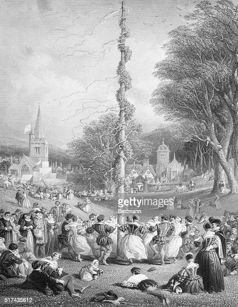 The May Pole Round the floral decked pole a group of merry makers is dancing merrily Undated engraving circa the Elizabethian period Engraving from J...