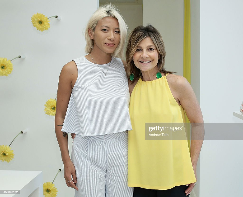 May Kwok and designer Lisa Perry attend Hamptons Magazine celebrates The New Lisa Perry store on June 14 2014 in East Hampton New York
