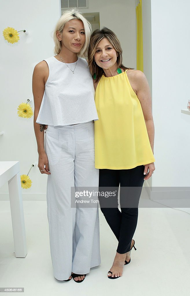DJ May Kwok (L) and designer Lisa Perry attend Hamptons Magazine celebrates The New Lisa Perry store on June 14, 2014 in East Hampton, New York.