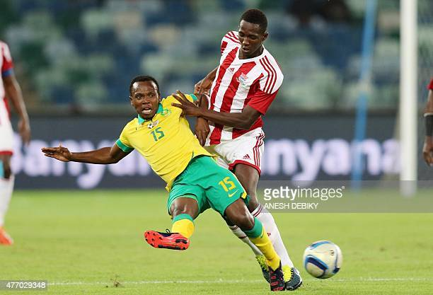 May Mahlangu of South Africa and Ebrima Sohna of Gambia fight for the ball during their Group M 2017 Africa Cup of Nations qualifying football match...