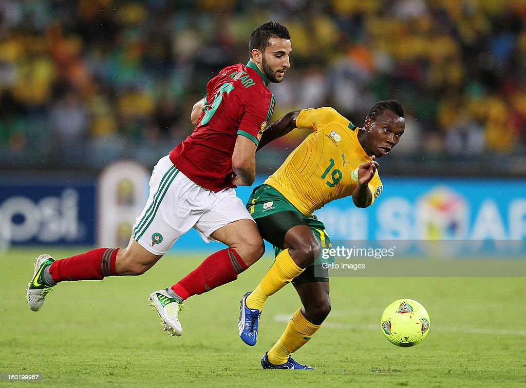 May Sphiwe Mahlangu of South Africa and Abelhamid el Kaoutari of Morocco in action during the 2013 Orange African Cup of Nations match between South Africa and Morocco from Moses Mabhida Stadium on January 27, 2013 in Durban, South Africa.
