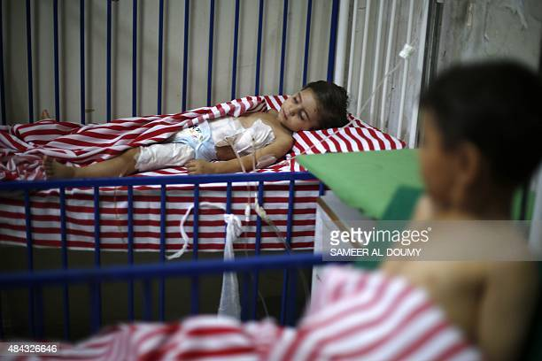 Maya a 4yearold Syrian girl lies in a hospital bed after she was injured the day before following air strikes by Syrian government forces on a...