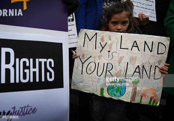 Maya Casillas joins migrant rights group during a vigil to protest against US President Donald Trump's new crackdown on 'sanctuary cities' outside...