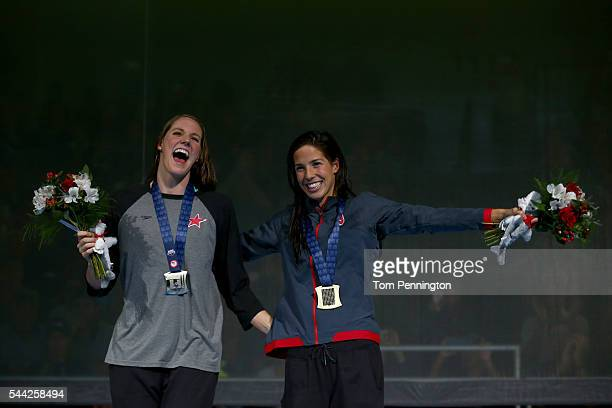 Maya DiRado and Missy Franklin of the United States participates in the medal ceremony for the Women's 200 Meter Backstroke during Day Seven of the...