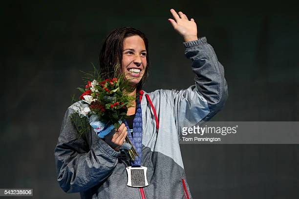 Maya DiRado of the United States participates in the medal ceremony for the Women's 400 Meter Individual Medley during Day One of the 2016 US Olympic...