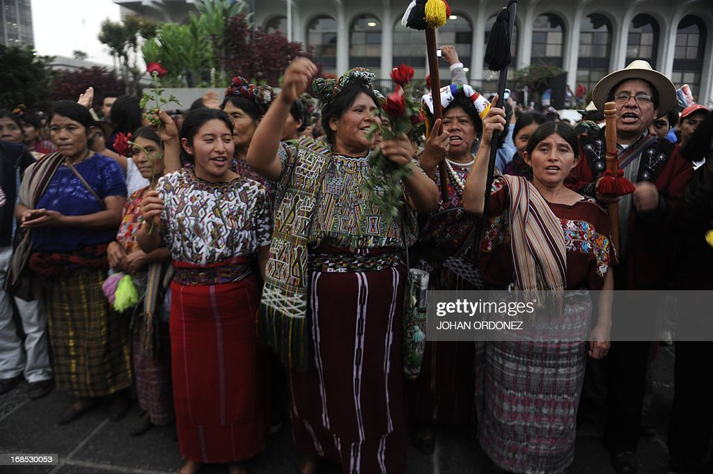 Maya Ixil women, including Guatemala's civil war survivor Maria Raymundo (C), celebrate after listening the sentence given to former Guatemalan de facto President (1982-1983), retired General Jose Efrain Rios Montt, 86, for crimes committed during his regime, in Guatemala City, on May 10, 2013. Rios Montt was found guilty of genocide and war crimes on Friday in a landmark ruling stemming from massacres of indigenous people in his country's long civil war. Rios Montt thus became the first Latin American convicted of trying to exterminate an entire group of people in a brief but particularly gruesome stretch of a war that started in 1960, lasted 36 years and left around 200,000 people dead or missing. AFP PHOTO / Johan ORDONEZ