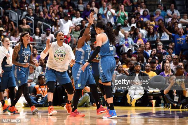 Maya Moore and Alexis Jones of the Minnesota Lynx high five each other during the game against the Los Angeles Sparks in Game Three of the 2017 WNBA...
