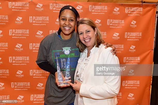 Maya Moore and Cheryl Reeve head coach of the Minnesota Lynx with the Western Conference Champions trophy after defeating the Phoenix Mercury in the...