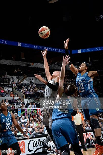 Maya Moore and Lindsay Whalen of the Minnesota Lynx defends against Kayla McBride of the San Antonio Stars in Game Two of the Western Conference...