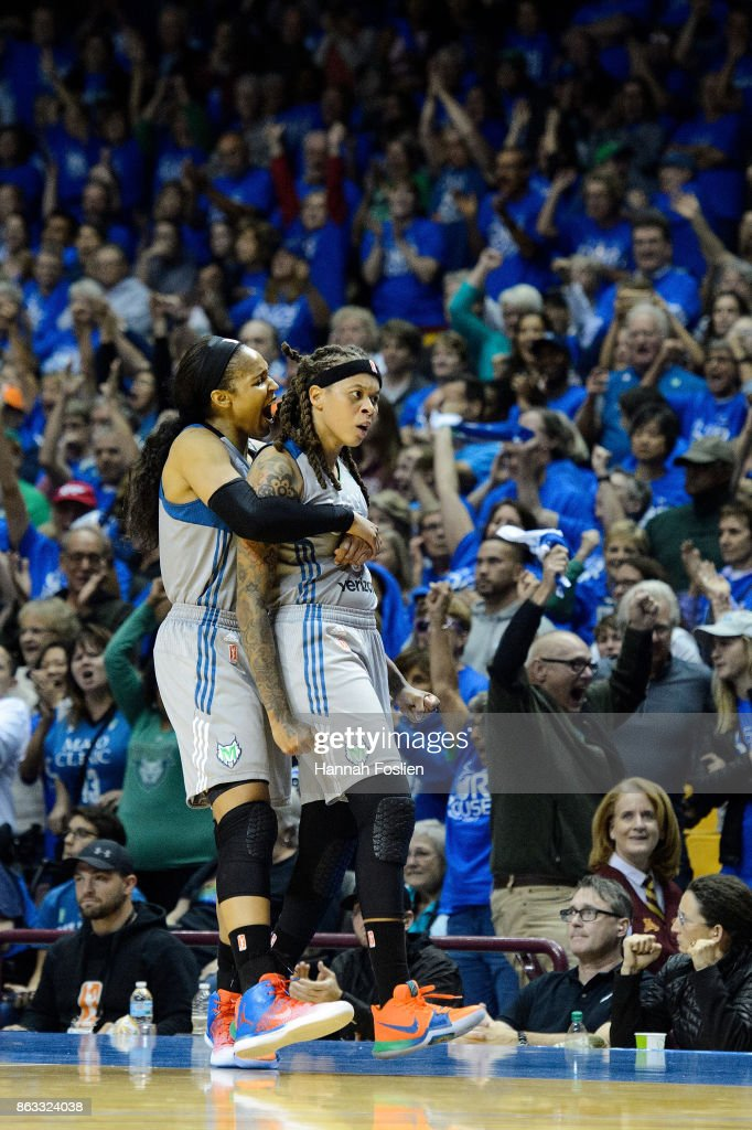 Maya Moore #23 and Seimone Augustus #33 of the Minnesota Lynx celebrate against the Los Angeles Sparks during the fourth quarter of Game Two of the WNBA Finals on September 26, 2017 at Williams in Minneapolis, Minnesota. The Lynx defeated the Sparks 70-68.