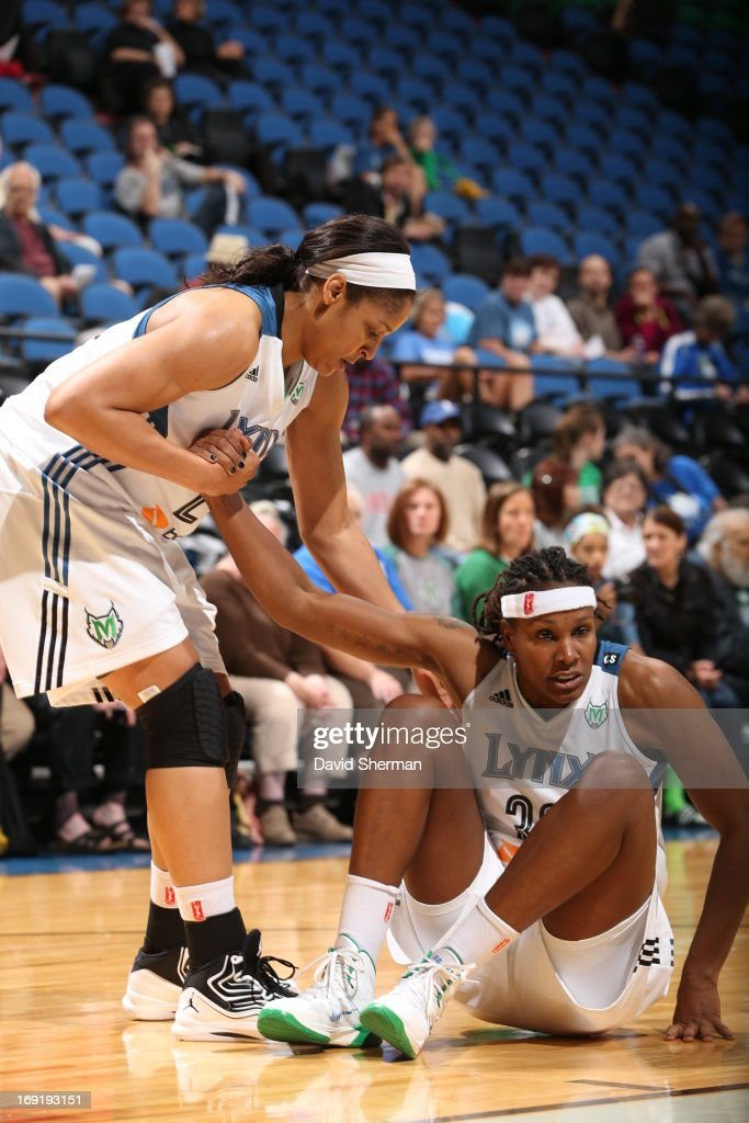 Maya Moore #23 helps out Rebekkah Brunson #32 of the Minnesota Lynx against Connecticut Sun during the WNBA pre-season game on May 21, 2013 at Target Center in Minneapolis, Minnesota.