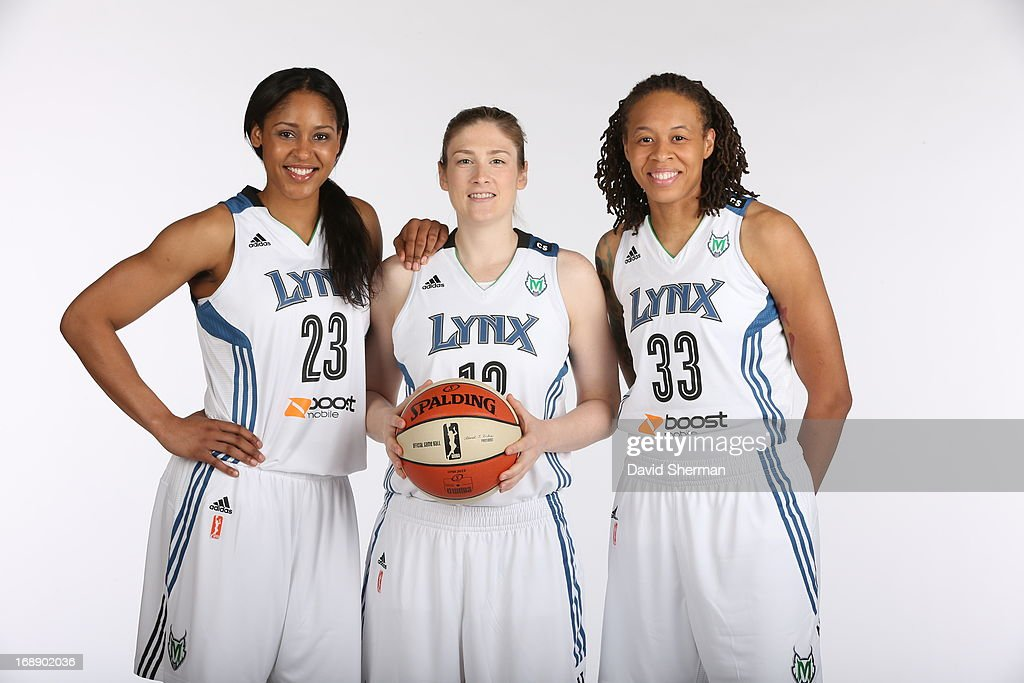 Maya Moore #23, Lindsay Whalen #13 and Seimone Augustus #33 of the Minnesota Lynx pose for portraits during 2013 Media Day on May 16, 2013 at the Minnesota Timberwolves and Lynx LifeTime Fitness Training Center at Target Center in Minneapolis, Minnesota.