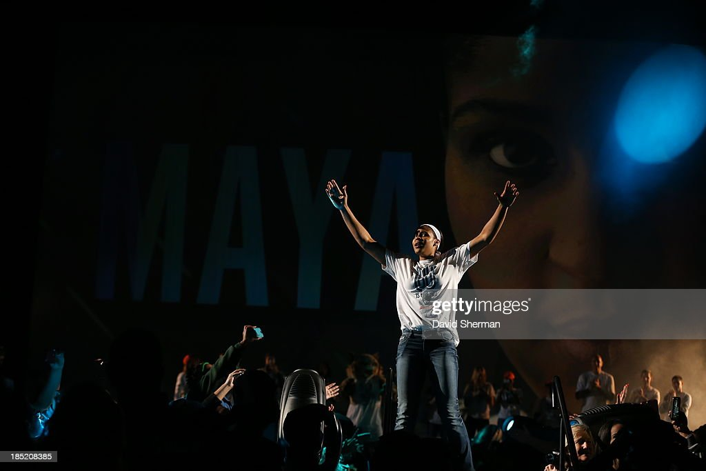 <a gi-track='captionPersonalityLinkClicked' href=/galleries/search?phrase=Maya+Moore&family=editorial&specificpeople=4215914 ng-click='$event.stopPropagation()'>Maya Moore</a> of the 2013 WNBA Champion Minnesota Lynx enters the Championship Rally at Target Center on October 14, 2013 in Minneapolis, Minnesota.
