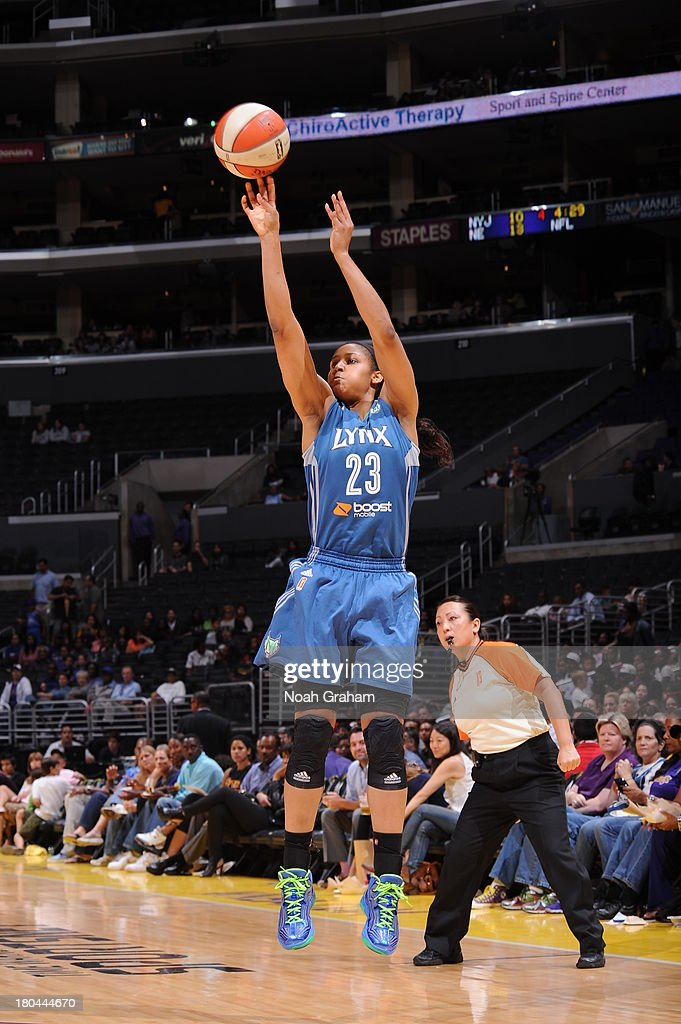 <a gi-track='captionPersonalityLinkClicked' href=/galleries/search?phrase=Maya+Moore&family=editorial&specificpeople=4215914 ng-click='$event.stopPropagation()'>Maya Moore</a> #23 of the Minnesota Lynx attempts a shot during a game against the Los Angeles Sparks at Staples Center on September 12, 2013 in Los Angeles, California.