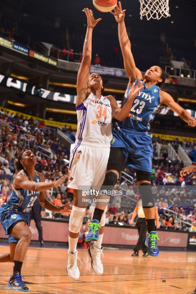 <a gi-track='captionPersonalityLinkClicked' href=/galleries/search?phrase=Maya+Moore+-+Basketball+Player&family=editorial&specificpeople=4215914 ng-click='$event.stopPropagation()'>Maya Moore</a> #23 of the Minnesota Lynx blocks the shot of Krystal Thomas #34 of the Phoenix Mercury on July 21, 2013 at U.S. Airways Center in Phoenix, Arizona.