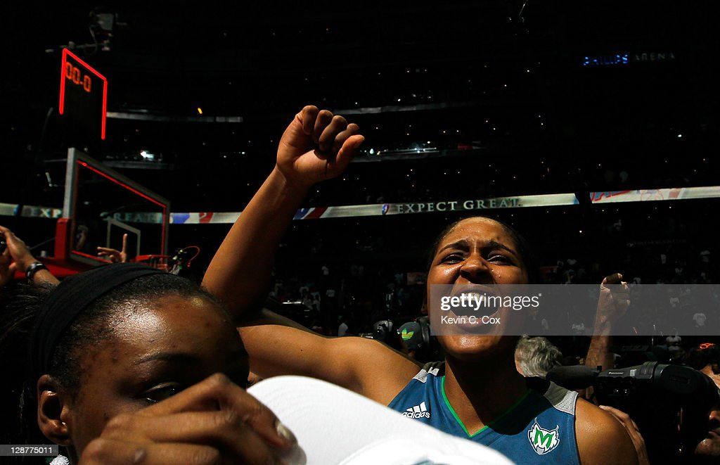 Maya Moore of the Minnesota Lynx celebrates their 7367 win over the Atlanta Dream in Game Three of the 2011 WNBA Finals at Philips Arena on October 7...