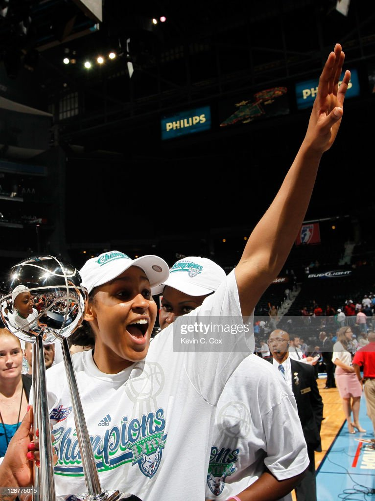 <a gi-track='captionPersonalityLinkClicked' href=/galleries/search?phrase=Maya+Moore&family=editorial&specificpeople=4215914 ng-click='$event.stopPropagation()'>Maya Moore</a> #23 of the Minnesota Lynx celebrates their 73-67 win over the Atlanta Dream in Game Three of the 2011 WNBA Finals at Philips Arena on October 7, 2011 in Atlanta, Georgia.