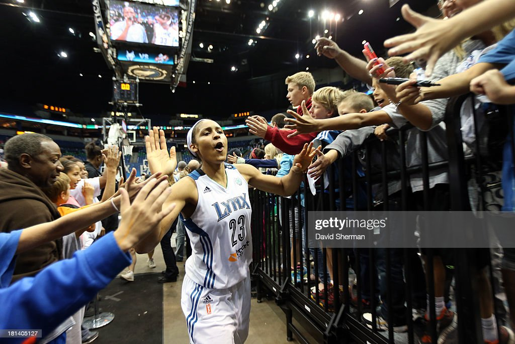 Maya Moore #23 of the Minnesota Lynx celebrates with fans after defeating Seattle Storm during the WNBA Western Conference Semifinals Game 1 on September 20, 2013 at Target Center in Minneapolis, Minnesota.