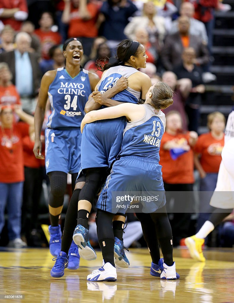 Maya Moore of the Minnesota Lynx celebrates with teammates after making the game winning shot to beat the Indiana Fever 8077 during Game Three of the...