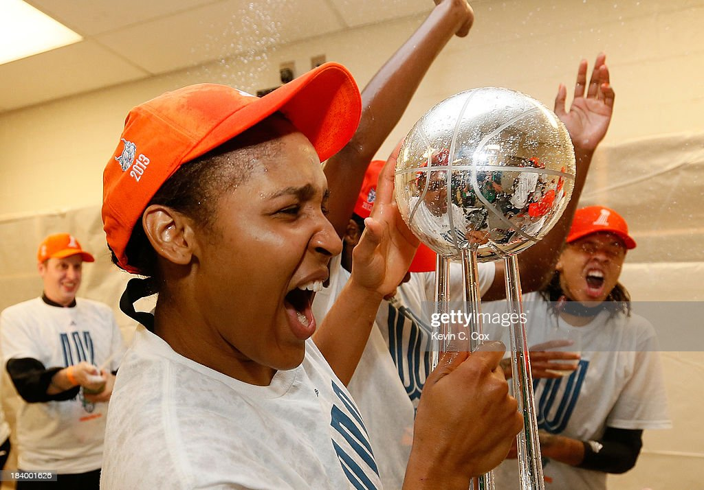 <a gi-track='captionPersonalityLinkClicked' href=/galleries/search?phrase=Maya+Moore&family=editorial&specificpeople=4215914 ng-click='$event.stopPropagation()'>Maya Moore</a> #23 of the Minnesota Lynx celebrates with the trophy after their 86-77 win over the Atlanta Dream in Game Three of the 2013 WNBA Finals at Philips Arena on October 10, 2013 in Atlanta, Georgia.