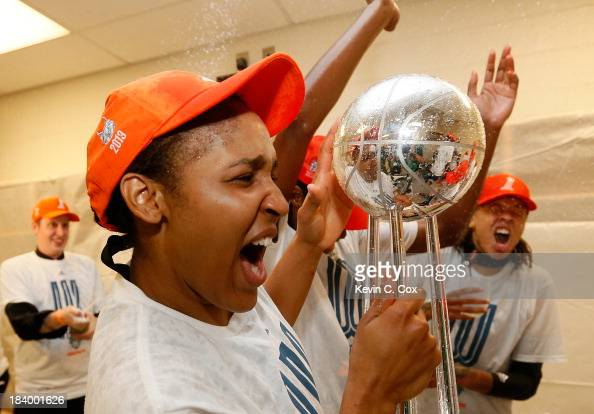 Maya Moore of the Minnesota Lynx celebrates with the trophy after their 8677 win over the Atlanta Dream in Game Three of the 2013 WNBA Finals at...