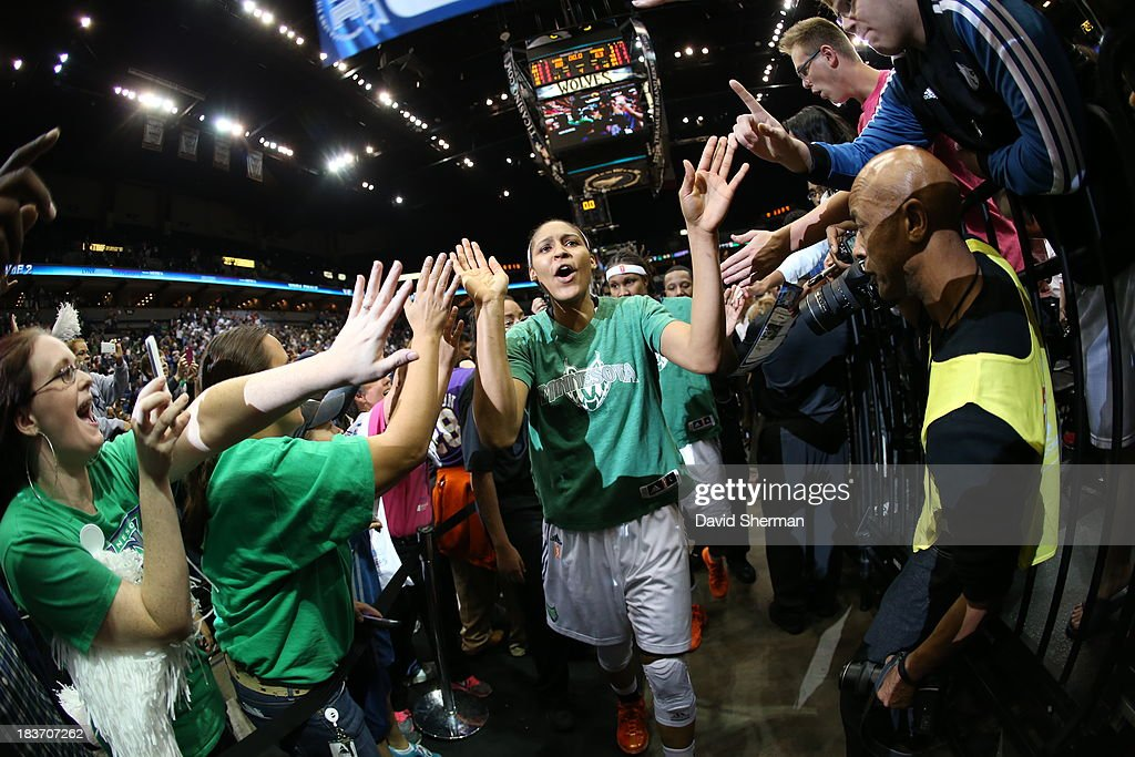 <a gi-track='captionPersonalityLinkClicked' href=/galleries/search?phrase=Maya+Moore&family=editorial&specificpeople=4215914 ng-click='$event.stopPropagation()'>Maya Moore</a> #23 of the Minnesota Lynx cheers with fans after the second win against The Atlantic Dream after Game 2 of the 2013 WNBA Finals on October 8, 2013 at Target Center in Minneapolis, Minnesota.