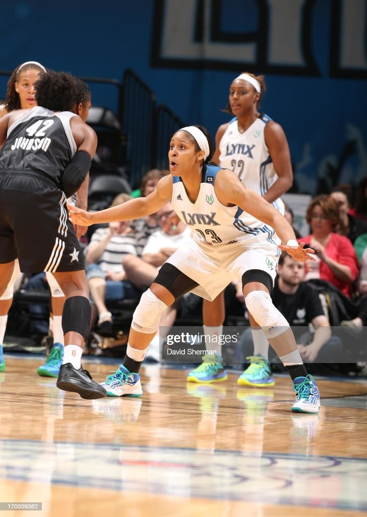 Maya Moore #23 of the Minnesota Lynx defends against Shenise Johnson #42 of the San Antonio Silver Stars during the WNBA game on June 11, 2013 at Target Center in Minneapolis, Minnesota.