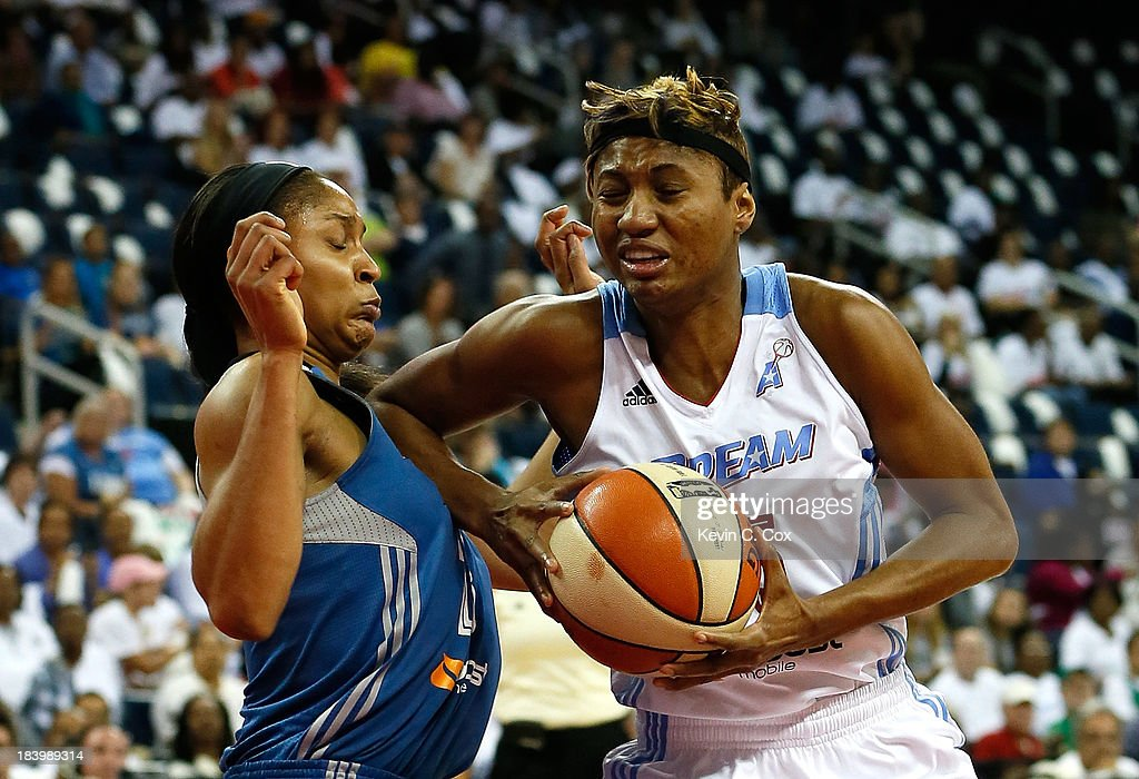 Maya Moore #23 of the Minnesota Lynx draws a charge from Angel McCoughtry #35 of the Atlanta Dream during Game Three of the 2013 WNBA Finals at Philips Arena on October 10, 2013 in Atlanta, Georgia.