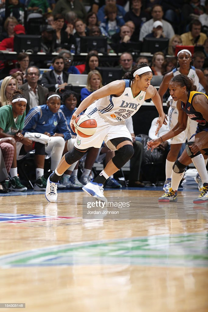 Maya Moore #23 of the Minnesota Lynx dribbles the ball against Tamika Catchings #24 of the Indiana Fever during the 2012 WNBA Finals Game Two on October 17, 2012 at Target Center in Minneapolis, Minnesota.