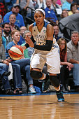 Maya Moore of the Minnesota Lynx dribbles the ball against the Phoenix Mercury during Game One of the WNBA Western Conference Finals on September 24...