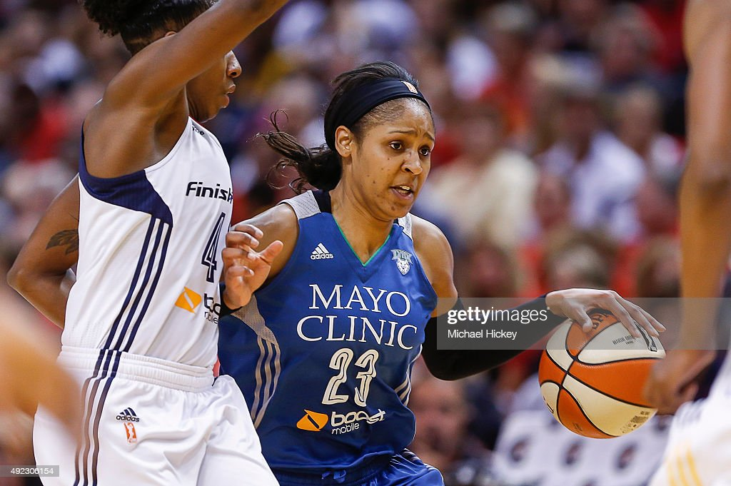 <a gi-track='captionPersonalityLinkClicked' href=/galleries/search?phrase=Maya+Moore+-+Basketball+Player&family=editorial&specificpeople=4215914 ng-click='$event.stopPropagation()'>Maya Moore</a> #23 of the Minnesota Lynx dribbles the ball downcourt as Shenise Johnson #42 of the Indiana Fever guards at Bankers Life Fieldhouse on October 11, 2015 in Indianapolis, Indiana.