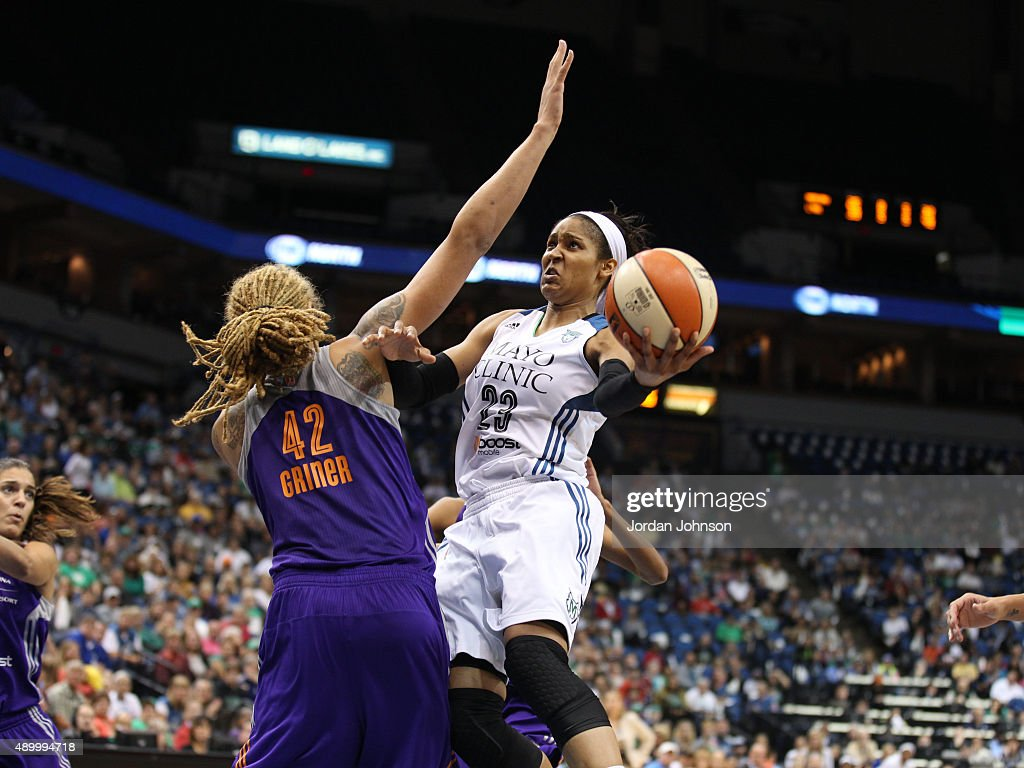 Maya Moore of the Minnesota Lynx drives to the basket against Brittney Griner of the Phoenix Mercury during Game One of the WNBA Western Conference...