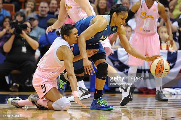 Maya Moore of the Minnesota Lynx fights for the ball against Iziane Castro Marques of the Connecticut Sun on August 22 2013 at the Mohegan Sun in...