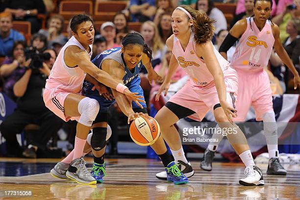 Maya Moore of the Minnesota Lynx fights for the ball against Iziane Castro Marques and Kayla Pedersen of the Connecticut Sun on August 22 2013 at the...