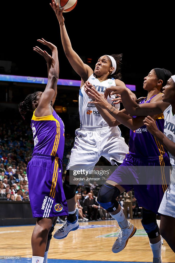 Maya Moore of the Minnesota Lynx goes for a layup against Nicky Anosike and Candace Parker of the Los Angeles Sparks during Game One of the 2012 WNBA...