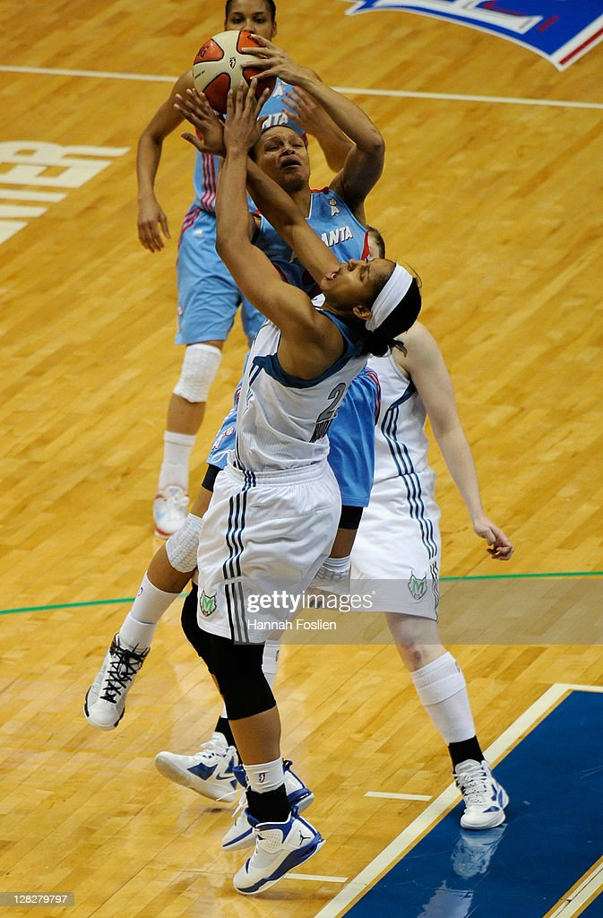 <a gi-track='captionPersonalityLinkClicked' href=/galleries/search?phrase=Maya+Moore+-+Basketball+Player&family=editorial&specificpeople=4215914 ng-click='$event.stopPropagation()'>Maya Moore</a> #23 of the Minnesota Lynx guards against <a gi-track='captionPersonalityLinkClicked' href=/galleries/search?phrase=Armintie+Price&family=editorial&specificpeople=4225806 ng-click='$event.stopPropagation()'>Armintie Price</a> #22 of the Atlanta Dream during the first quarter of Game Two of the 2011 WNBA Finals on October 5, 2011 at Target Center in Minneapolis, Minnesota.