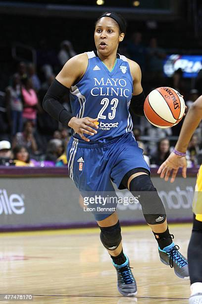 Maya Moore of the Minnesota Lynx handles the ball against the Los Angeles Sparks at Staples Center on June 16 2015 in Los Angeles California