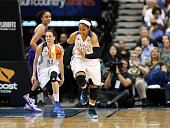 Maya Moore of the Minnesota Lynx handles the ball against the Phoenix Mercury during Game One of the WNBA Western Conference Finals on September 24...